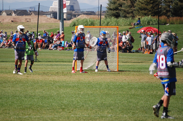 Goalie Caleb Stroman and the Parker defense played well in the World Lacrosse Championships and the Under-15 team beat Kansas True, 14-1, in a game played July 13 at Dick's Sporting Goods Park. Also shown for the team are, from left to right, Brendan Roth, Hunter Jacobson, Caleb Stroman and Johnny Shrabacker in the foreground.