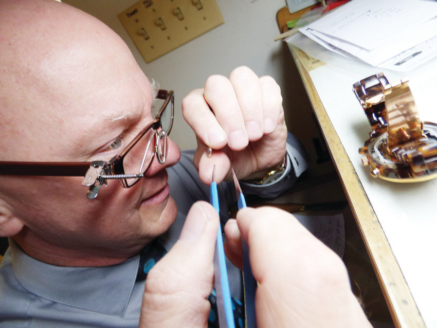 "Karl Tanke swaps out a battery in a customer's watch. Karl is a certified master watchmaker. ""When I need to make parts for an old mechanical watch, I can,"" Karl said. ""People don't like to pay for them, though."""