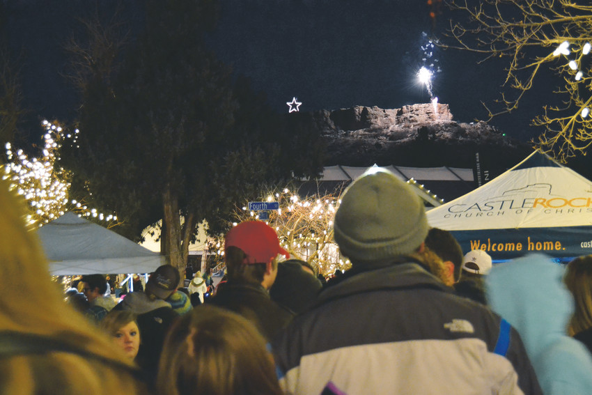 The sound of fireworks reverberates through the cold air Nov. 18 as Castle Rock residents watch the star on top of The Rock light up. Thousands of people attended the annual Starlighting festivities to celebrate the start of the holiday season.