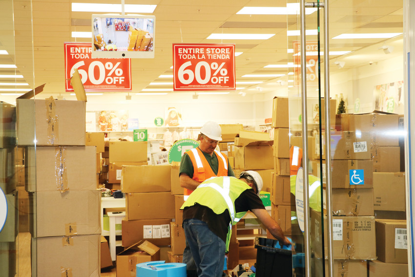 Retailers in the Colorado Mills Mall prepare for reopening day on Nov. 21.