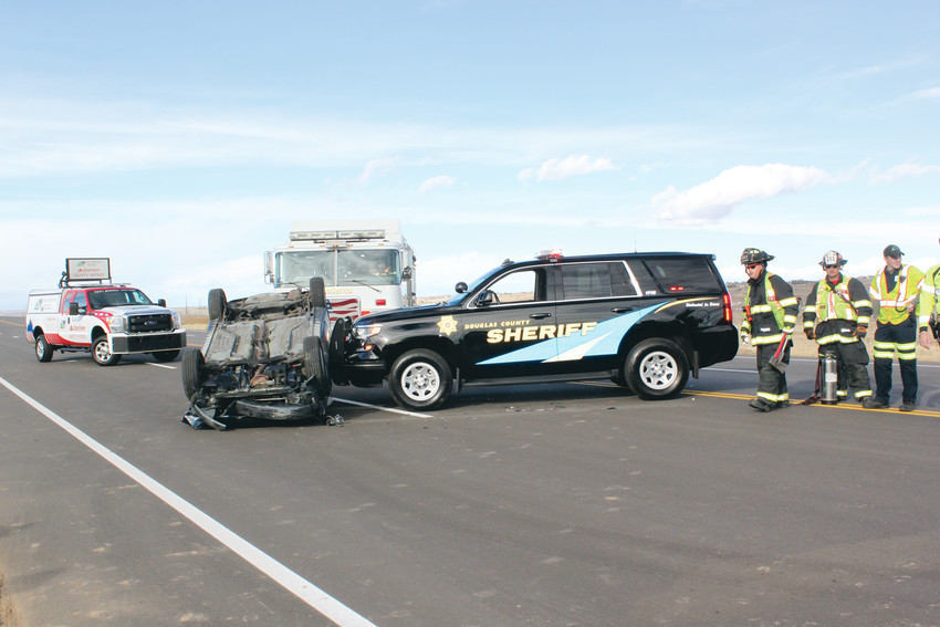 A Douglas County Sheriff's deputy uses his patrol vehicle to push an overturned car off the road, as part of a training exhibit at Douglas County's Emergency Vehicle Operations Center's Traffic Incident Management Track, the second of its kind in the United States.