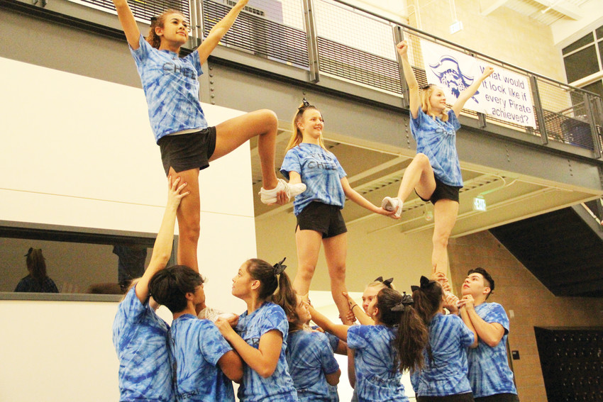 The Englewood High School cheer team practices at EHS Nov. 17. The team, led by coach Ginger Rode, won first place at the Colorado 7 League meet in November.