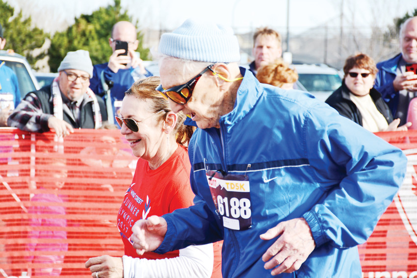 Bob McAdam, 97, finishes the Turkey Day 5K in 48 minutes and 33 seconds, setting a new world record for his age group. He was one of thousands of participants in the annual run or walk hosted by the Highlands Ranch Chamber of Commerce.