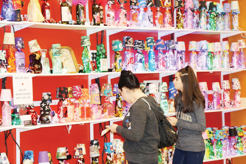 Shoppers peruse some of the locally made holiday gifts at A Borgata, which opened shop again in Colorado Mills mall on Nov. 21.