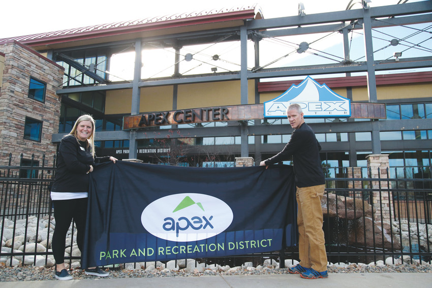 Katie Groke Ellis and Rob Anna unveil the new logo for the Apex Park and Recreation District.