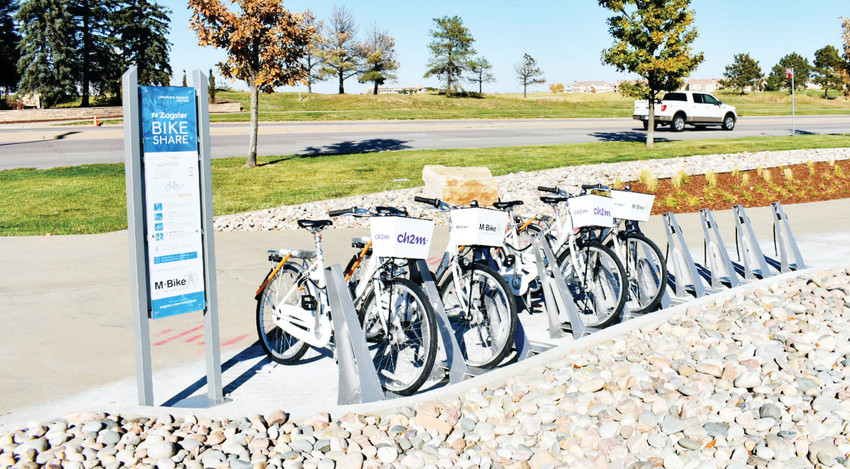 M-bikes lined up at one of 11 stations in the Meridian International Business Center, ready to be unlocked and ridden by the community.