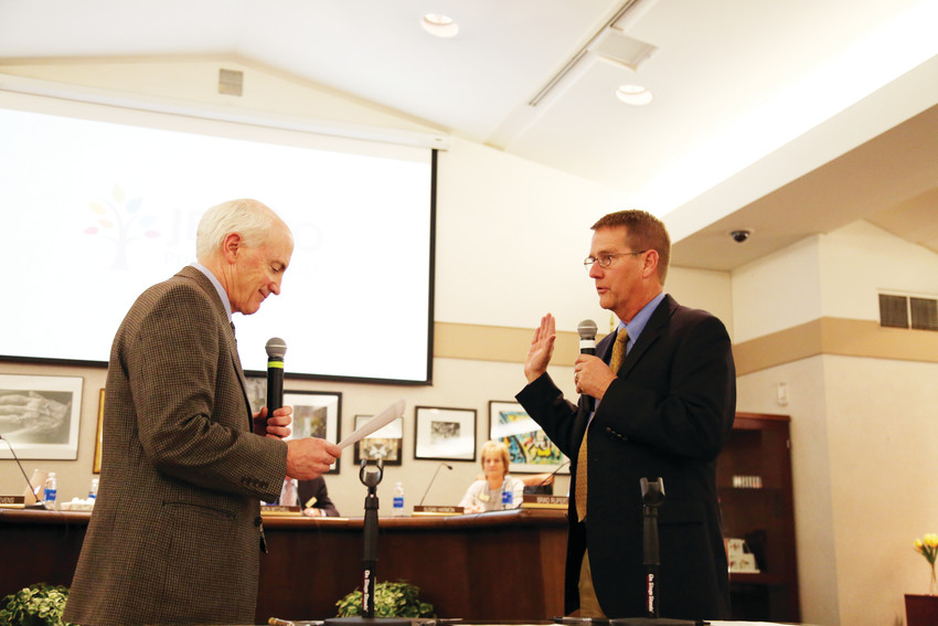 Philip J. McNulty, District Court Chief Judge of the 1st Judicial District, swears in Brad Rupert for a four year term serving on the Board of Education for Jefferson County Public Schools.