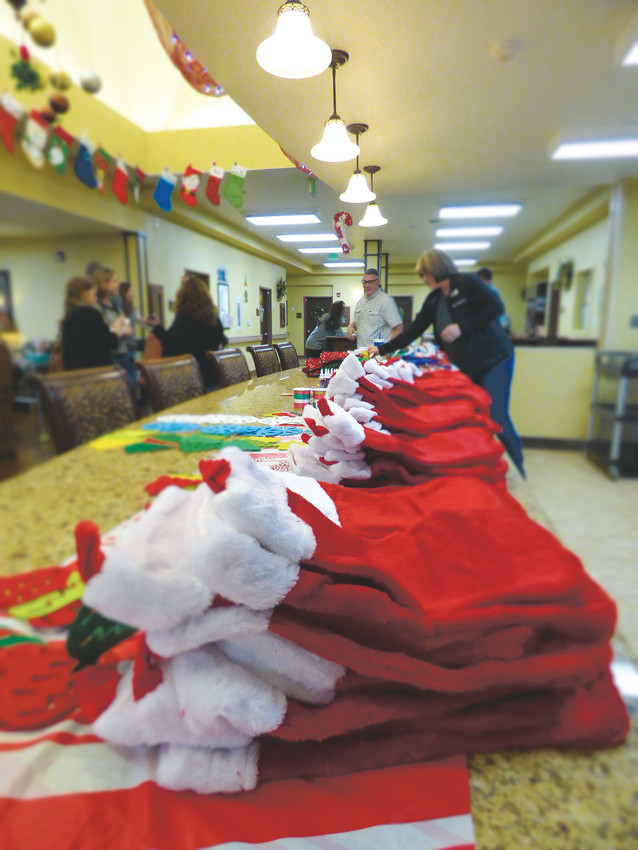 Stockings are lined up before being decorated at Highline Place during a visit by young people from Shiloh House.