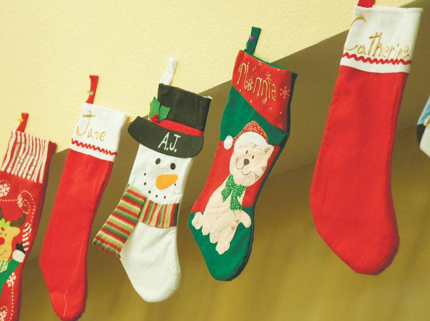 The stockings were hung by the community room with care when youths from Shiloh House visited Highline Place in Littleton.