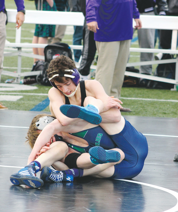 Douglas County's Austin Kelchen gains control in his 170-pound match against ThunderRidge's Cy Paul in a Dec. 1 dual meet which was held outside at the Douglas County Stadium. ThunderRidge won the dual meet, 41-36, and the schools hope to have another outdoor match next season.