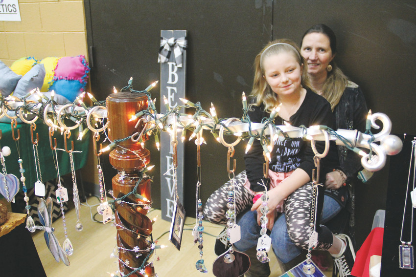 Angelene Duffy, 9, and mother Amy Duffy, 45, run a booth at the Goodson Recreation Center's Arts and Crafts Fair Dec. 2. Duffy, a Lakewood resident, sells handmade jewelry throughout the year at similar shows and at farmer's markets.