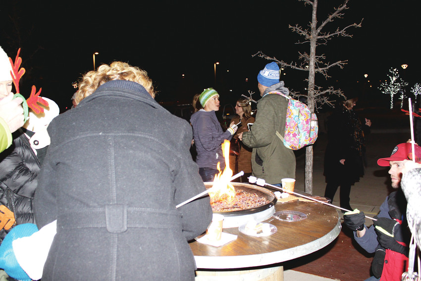 Lone Tree residents braved chilly weather to enjoy S'mores, Santa and the lighting of the Christmas tree at the Lone Tree Arts Center.