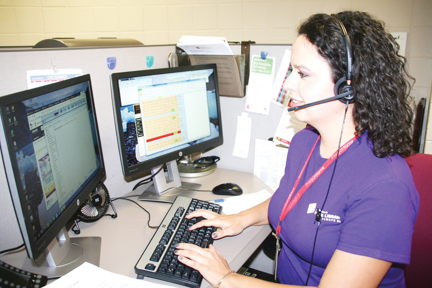 Elisa Higuera, a bilingual patron experience associate who works in the Jefferson County Public Library's call center, can assist callers in English or Spanish.
