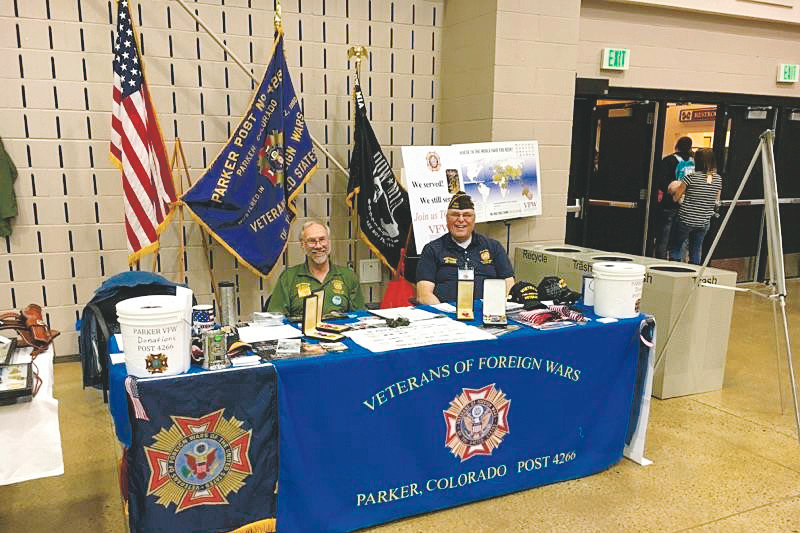 Veterans Gerard Brushaber and Evan Totten man the Parker VFW Post 4266 booth at a community function. Veterans of the post are trying to raise funds to build a facility where veterans can gather and hold events.