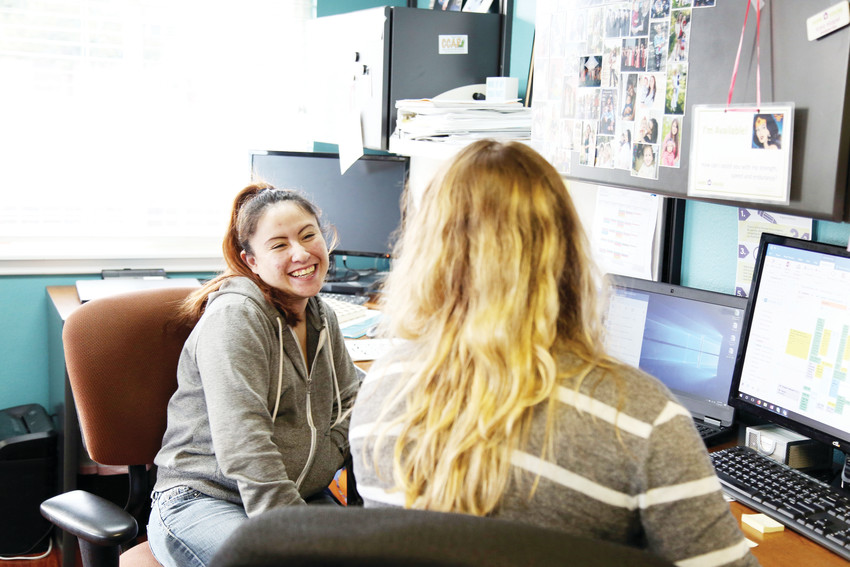 Rosa Stevenson, 21, talks with Kara Mapel, residential program manager at Hope House, about the next steps to completing her GED.
