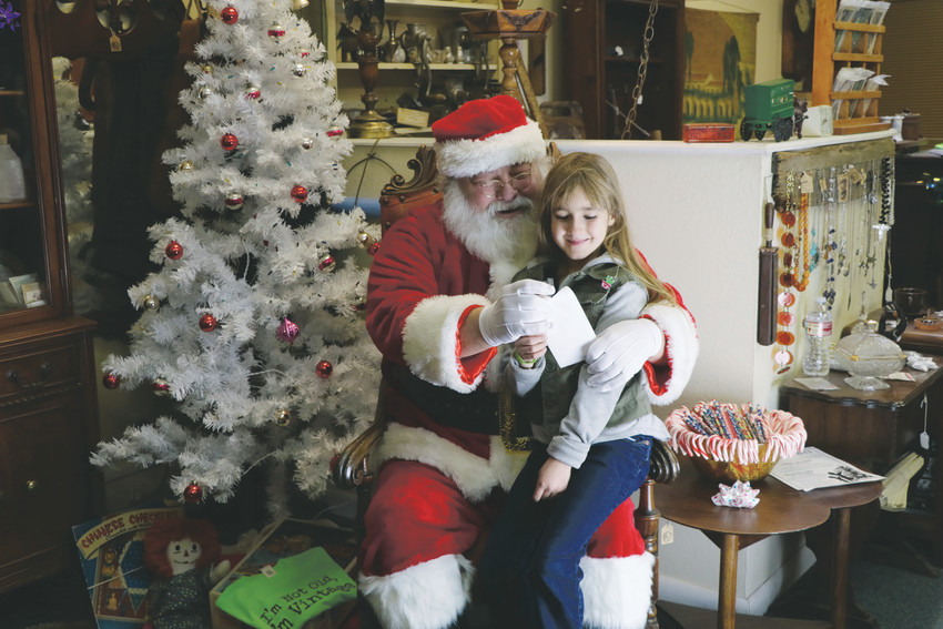 The Dec. 5 Elizabeth tree auction helped usher in the holidays and was primarily for adults but there was also the opportunity for children to visit Santa. Charli Kugler spent time with Santa going over her Christmas gift list.