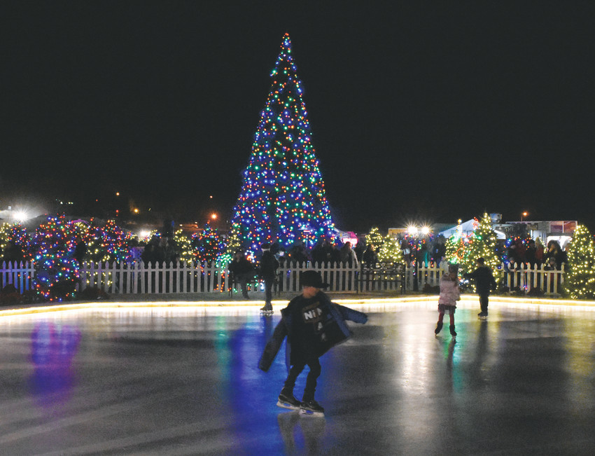 Skaters take advantage of a portable outdoor rink Dec. 8 at Thornton WinterFest in Carpenter Park.