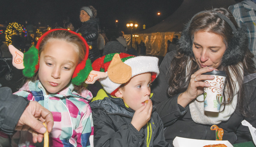 Brooklyn Hill, left, 8, and brother Collin, 5, of Brighton, enjoy some dinner with their mother, Alana, at Thornton WinterFest, Dec. 8 at Thornton's at Carpenter Park.
