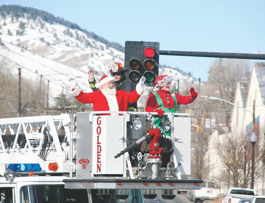 One of the best things about the holiday season is seeing the children's faces light up when they see Santa riding along in a big fire truck, said Golden Fire Chief John Bales. In this picture, Santa and Mrs. Claus, accompanied by a Golden firefighter in full gear, wave to the crowd in 2015 during one of the Golden Chamber of Commerce's holiday parades.