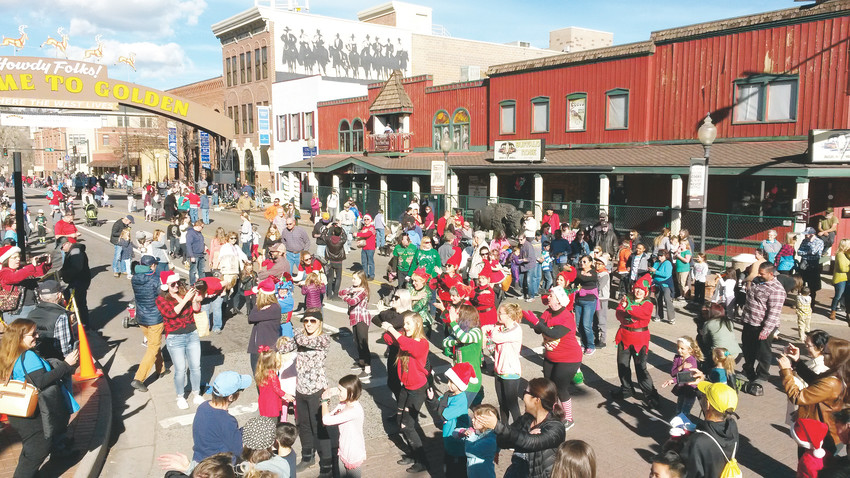 Pictured is the crowd before this year's Dec. 2 parade. This season's final parade will take place at 10:30 a.m. Dec. 16. The event will also feature plenty of shopping opportunities, family-friendly activities and other attractions following the parade.