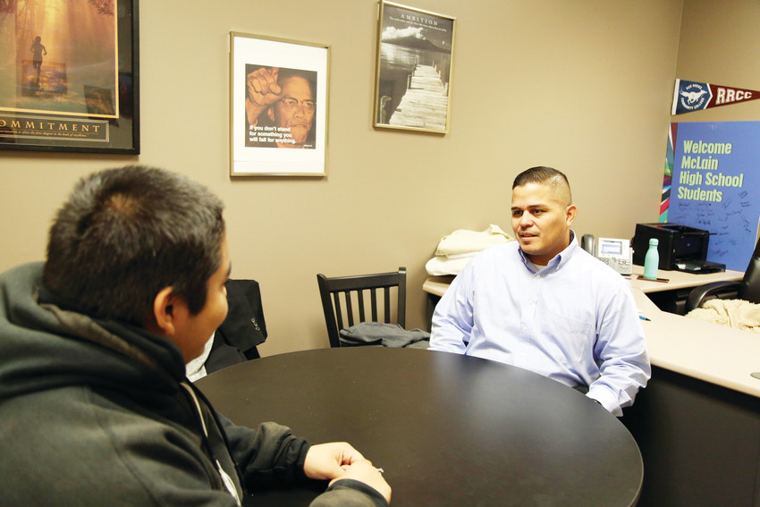 Oscar Fonseca, community and family connections liaison for Jeffco schools, meets with a student at McLain Community High School. Fonseca is one of five liaisons working with families experiencing homelessness at all schools in Jeffco.