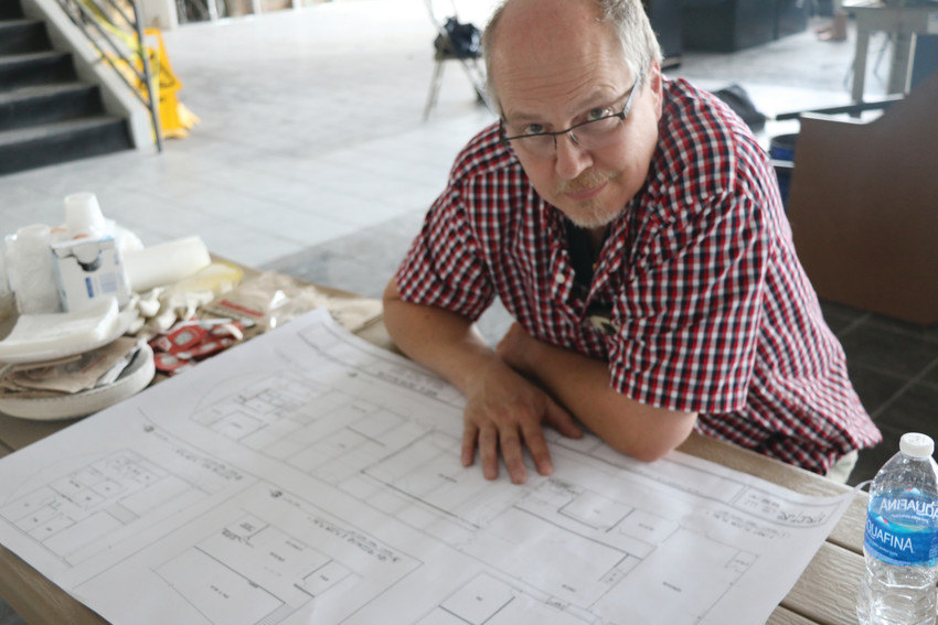 John Harris, marketing and technology lead with Reed Art and Imaging, with the plans for the company's new home in Lakewood's 40 West Arts District.  The completed storefront opened earlier this year.