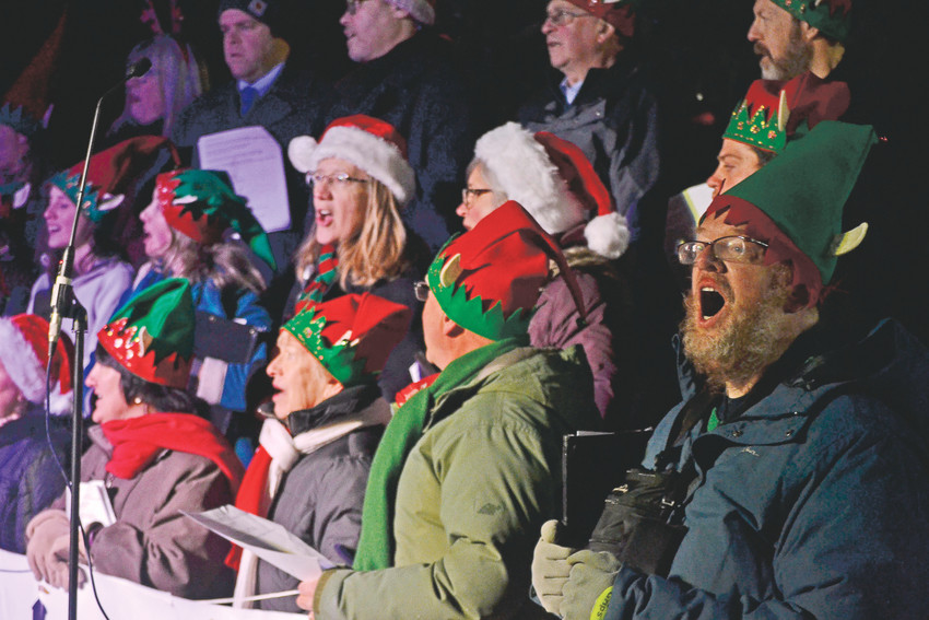 The Arvada Chorale serenades the Lagniappe crowd with Christmas tunes during the annual celebration in Olde Town on Tuesday, Dec. 5.