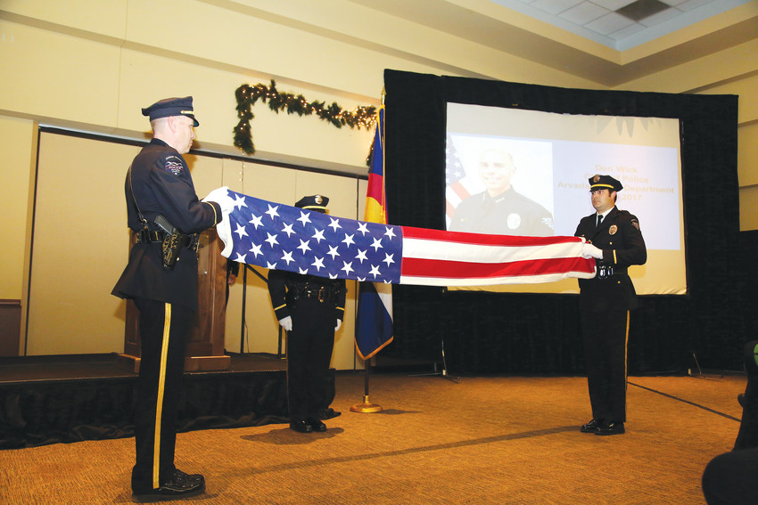 The Arvada Police Honor Guard performs a flag folding ceremony in honor or retiring Arvada Police Chief Don Wick.