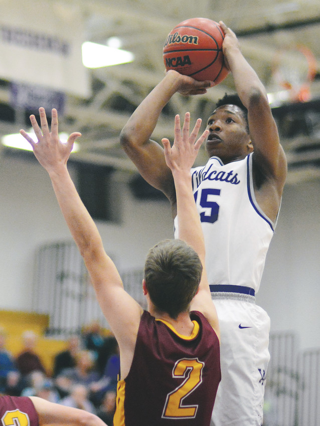 Arvada West senior Isaiah Brewer (15) pulls up for a jumper in the paint during the Wildcats' non-league loss to Rocky Mountain on Dec. 12 at Arvada West High School. Brewer did score a team-high 18 points for A-West.