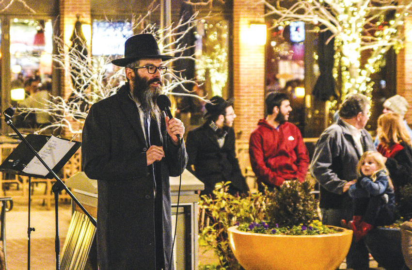 Rabbi Benjy Brackman, of Chabad of Northwest Metro Denver, presides over Chanukah menorah lighting ceremonies at the Orchard Town Center on the holiday's first night Dec. 12, 2017.