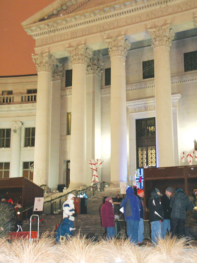 A crowd begins to gather for the 28th annual We Will Remember: Homeless Persons' Memorial Vigil. The event, put on by the Colorado Coalition for the Homeless, took place on Dec. 21 on the front steps of the Denver City and County Building. A few hundred people attended the event.