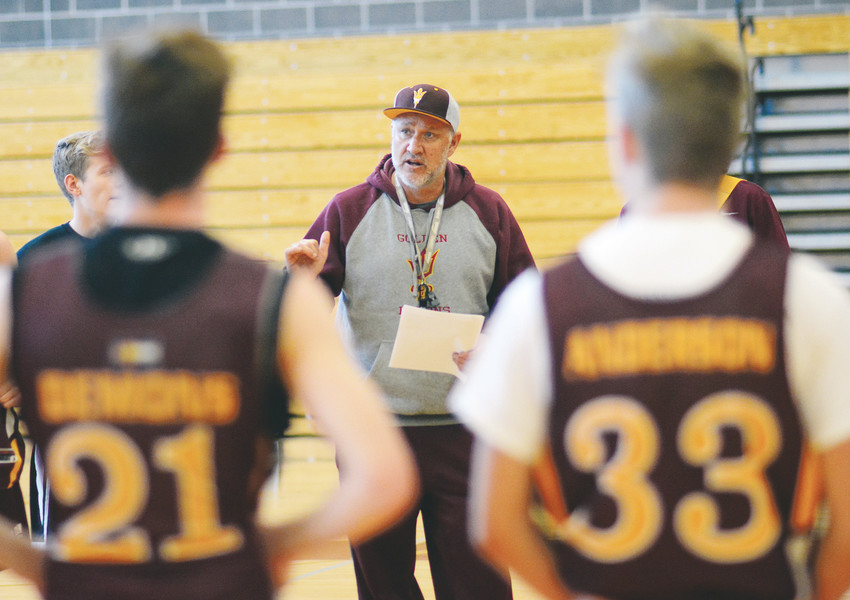 Golden boys basketball coach John Anderson at an early-season practice this year.