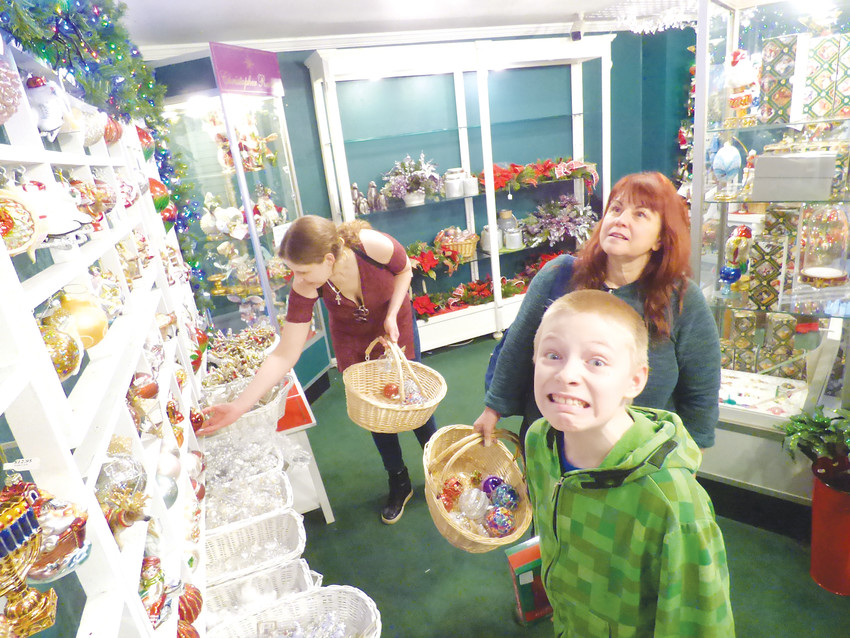 Mom Sue Cuthbert-Peck, right, flanked by daughter in law Denisha Miskinon and grandson Ash Peck, hunt for deals for Christmas 2018.