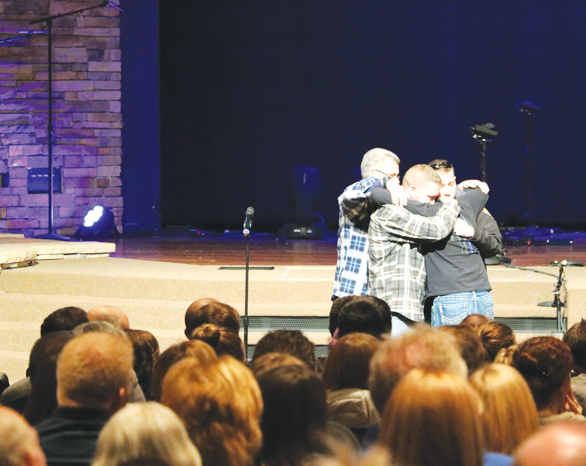 Colleagues of Douglas County Deputy Zackari Parrish, who was killed in the line of duty on Dec. 31, hold each other at a vigil Jan. 1 at Mission Hills Church in Littleton.