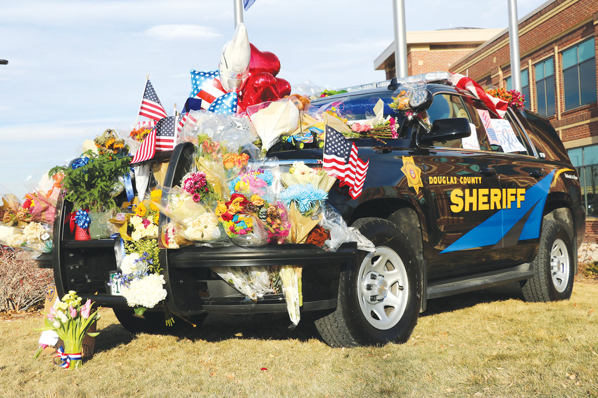 A memorial honoring Douglas County Deputy Zackari Parrish at the sheriff's substation in Highlands Ranch, 9250 Zotos Drive, grows.