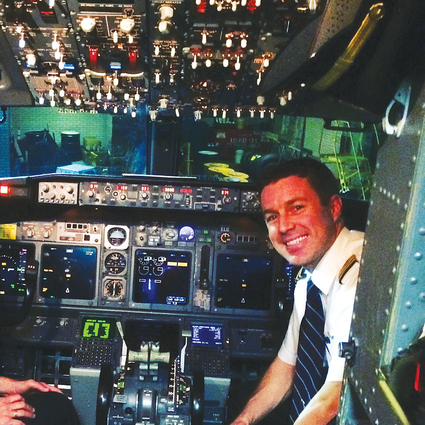 Matt Stege, co-pilot of a Boeing 737 for a major airline, gets his picture taken in the cockpit of the plane. Stege, 33, of Denver knew he wanted to be a professional pilot since he was 14.