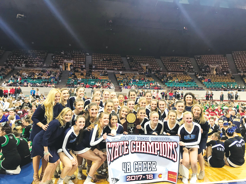 Valor Christian athletes pose with the trophy after winning their second straight Class 4A cheer championship.