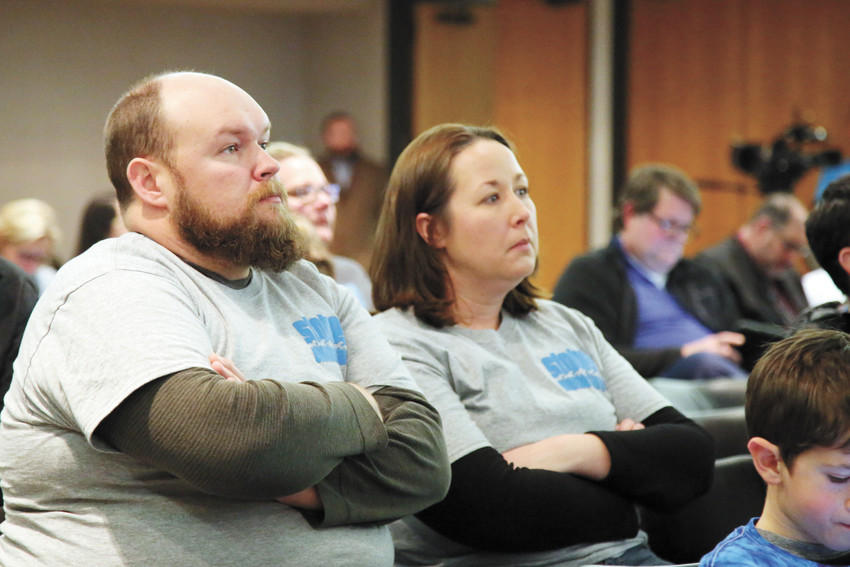 Stober Elementary School parents Gail and Cody Browyer listen to the Jeffco Board of Education discuss school closures at the Jan. 26 board meeting. Stober was one of five schools being considered for closure as a budget cut strategy, though only Pleasant View ended up being closed.