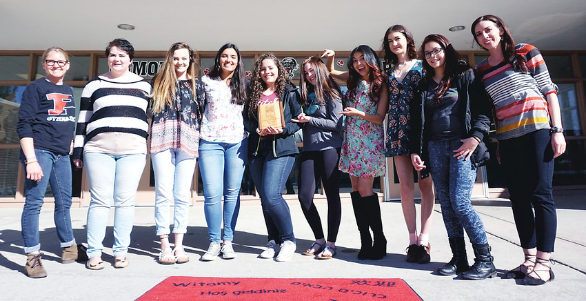 Pomona High School's Diversity Club pose with the plaque it received after collecting 1,852 pounds of food for the inaugural Cans Around the Campus food drive last year. Pomona raised the most food of the nine Jeffco high schools that took part in the week-long food drive that netted more than 5,000 pounds of food for the Arvada Community Food Bank and The Action Center in Jeffco.