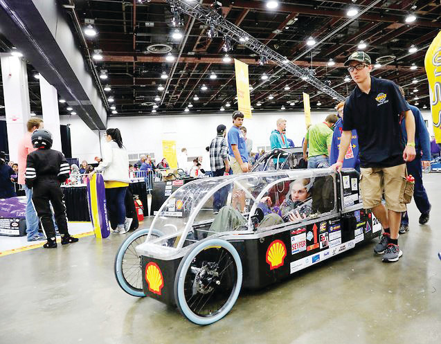 Wheat Ridge High School STEM students with their first place-winning hydrogen fuel cell car, Pitchfork, at the Shell Eco-Marathon in Detroit April 27-30.