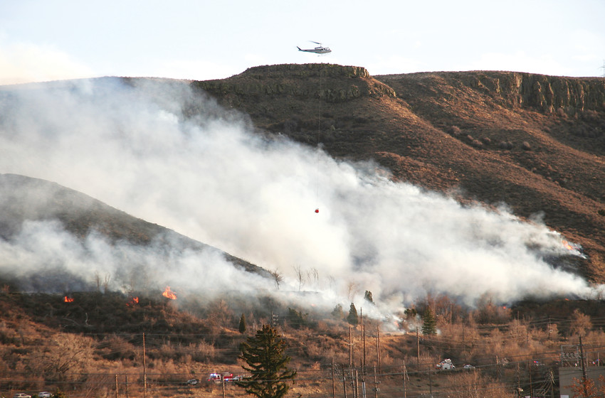 Helicopters dropped water on the South Table Mountain brush fire Thursday afternoon, as the flames burned through heavy, and dry vegitation just south of 32nd Avenue.