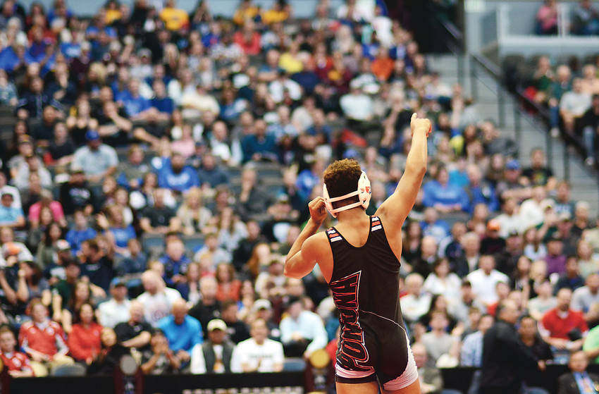 Pomona sophomore Theorius Robison acknowledges the crowd after winning the Class 5A 132-pound wrestling title last year at Pepsi Center. Robison is now a 2-time individual state champion, halfway to having a shot at becoming Pomona's first 4-time state champion in the program's history.