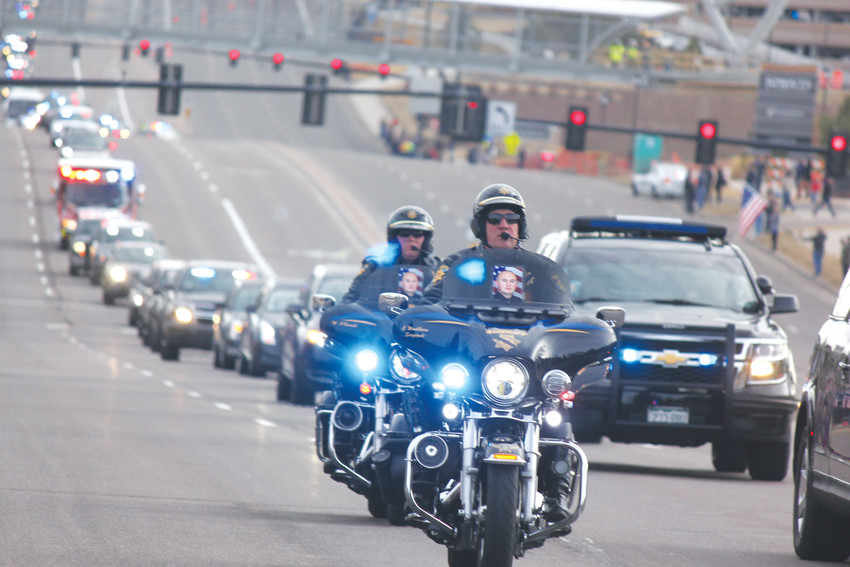 Douglas County deputies escort the family of Deputy Zackari Parrish along Lincoln Avenue. Photo by Tabatha Stewart