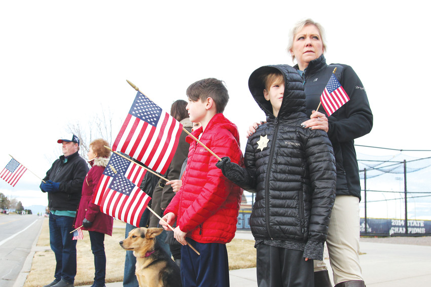Shanah Windey-Bale, of Highlands Ranch, stands along the procession route with her twin sons, Kiefer and Kole Bale, 9, to pay respects to Deputy Zackari Parrish.