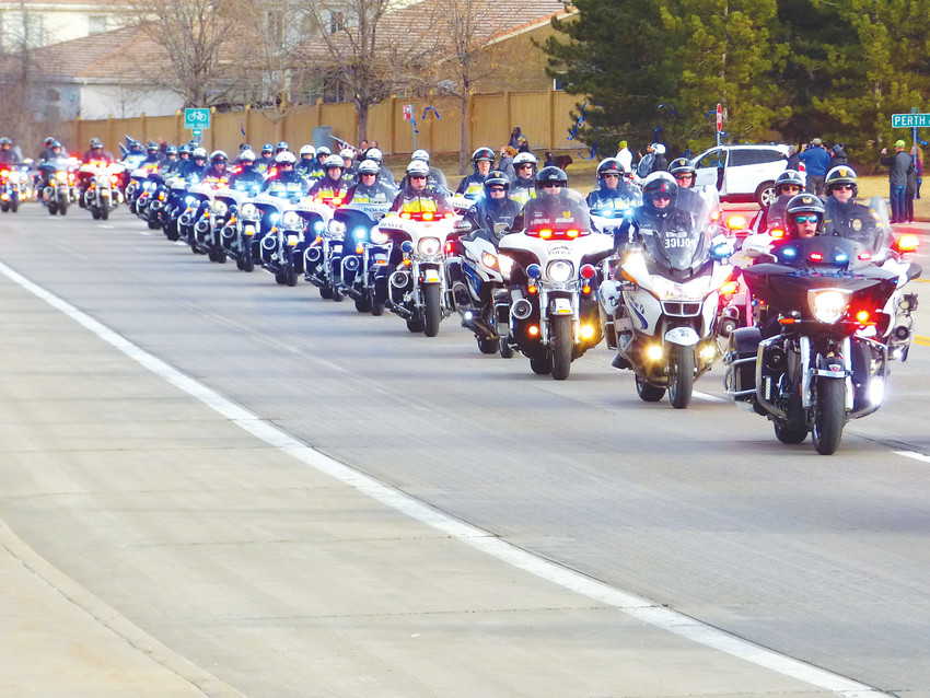 Motorcycle officers from Castle Rock, Denver and other departments head the column of Deputy Zackari Parrish's funeral procession.