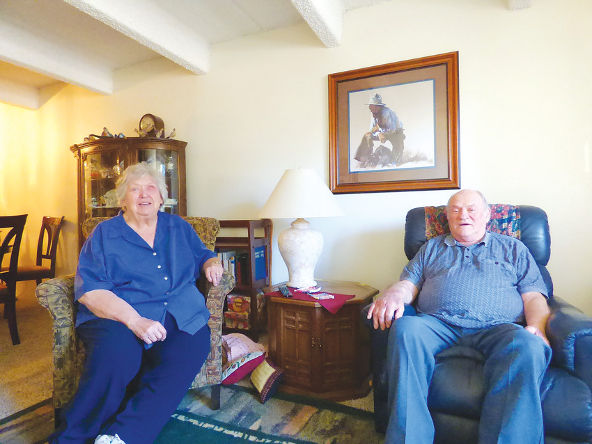 Carolyn Stubbert, left, and husband Jim sit in the living room of their apartment at The Windermere, formerly known as Southview Place Towers. The Stubberts moved back in after a fire displaced dozens of residents.