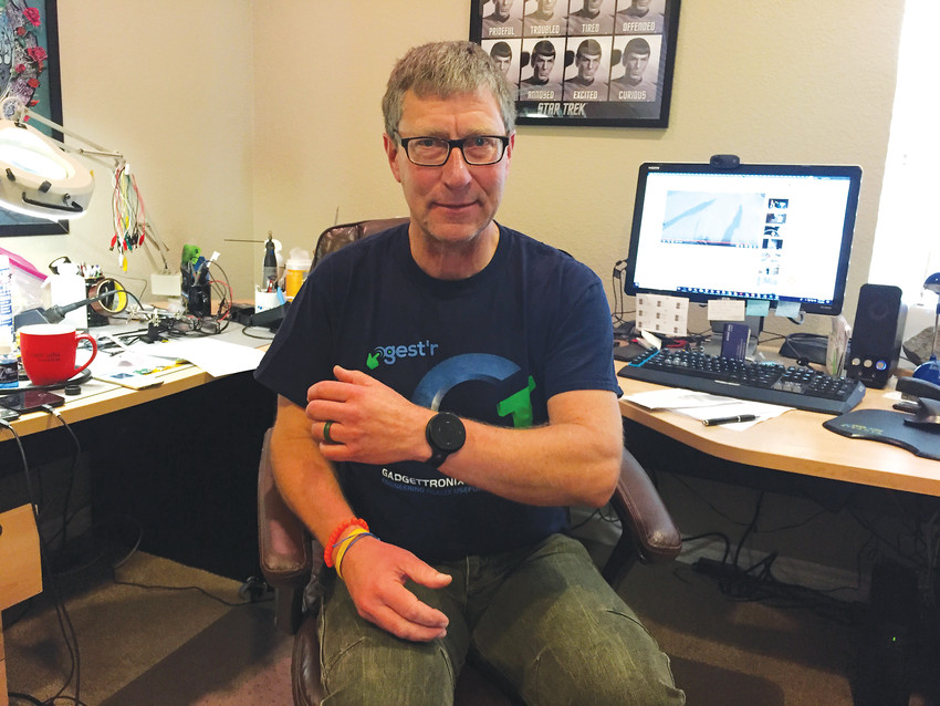 Gadgettronix president Anthony Dobaj sits in his Highlands Ranch home office wearing the gestr on his left wrist. In the works since 2012, the black gadget allows him to control his music and other smartphone features with a tap of a finger or wave of a hand.
