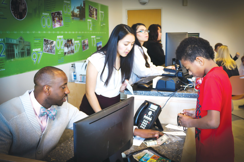 Bankers at the Young Americans Center for Financial Education help children set up checking or savings accounts. In addition to traditional banking services, the center also provides classes and seminars for children who want to learn more about financial stability.