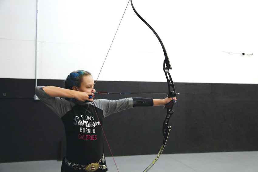 Marya Remines practices her form at Empty Quiver Archery.