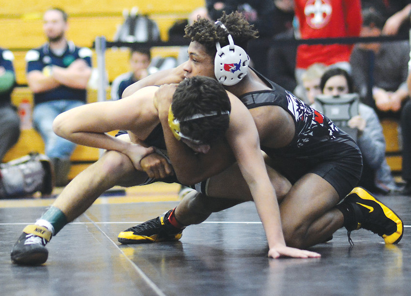 Pomona junior Theorius Robison, right, didn't take a break between football and wrestling season this year. The 132-pound wrestler is halfway from becoming a four-time individual state wrestling champion.